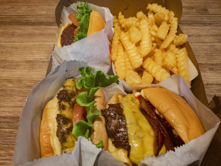 Photo of shake shack burgers and fries