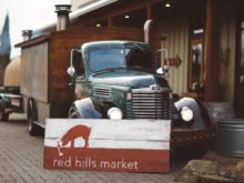 Photo of green mobile kitchen truck at red hills market
