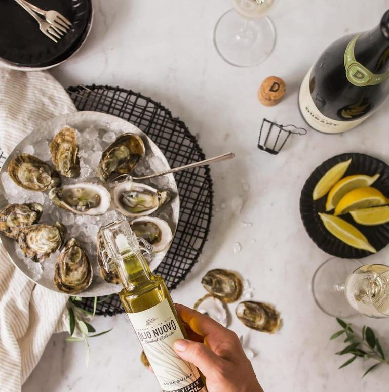 Image of plate of oysters and bottle of durant olive oil