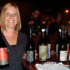 Karissa Kruse, pouring Argot Wines with a smile. Photo by Melissa Vogt